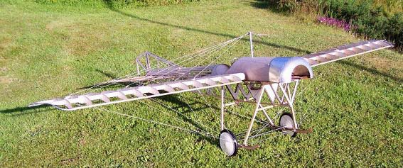 An uncovered DB Blackburn Monoplane model sitting on the grass fully rigged